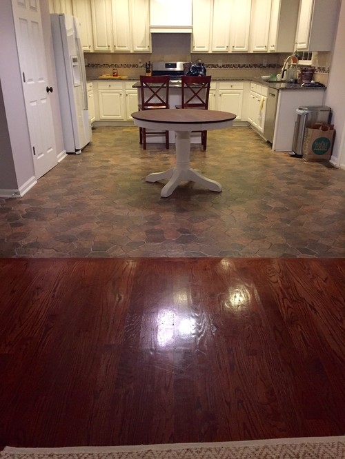 Kitchen floor dilemma tile vs hardwood for Hardwood floors vs carpet