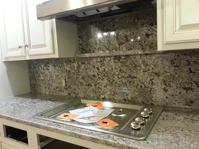 bianco antico counter top and full height granite back