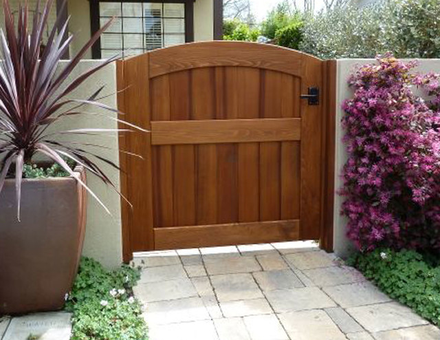 Garden wooden gate archtop attached to stucco wall using for Outdoor garden doors