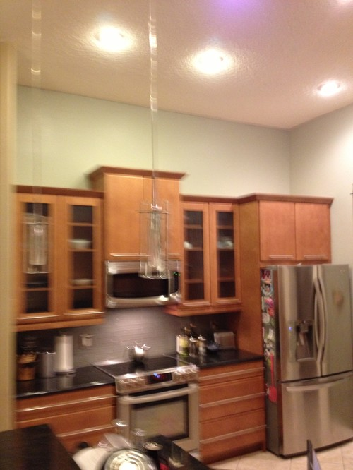what to put above kitchen cabinets in a tall kitchen