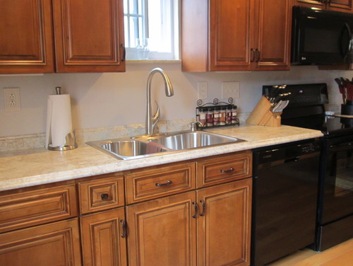 Rustic brown kitchen cabinets used to do a complete for Kitchen cabinets reno