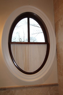 Oval window with pleated shade traditional nashville for Window treatment for oval window