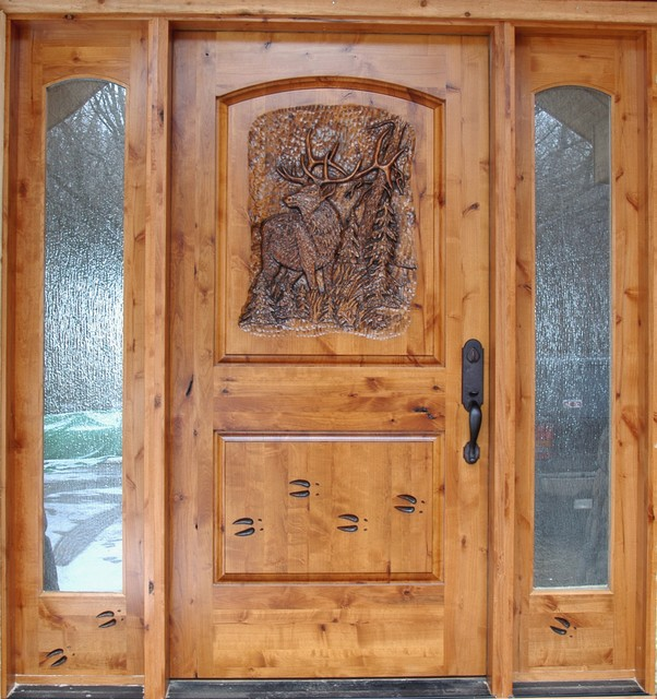 Knotty alder entrance with hand carved door front doors for Knotty alder wood doors