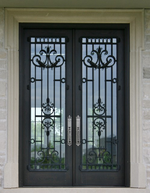 DOUBLE GLASS DOOR WITH EXTERIOR WROUGHT IRON GRILL