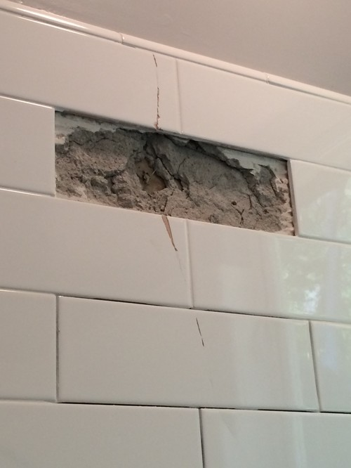 Cracked Subway Tiles In Remodeled Bathroom