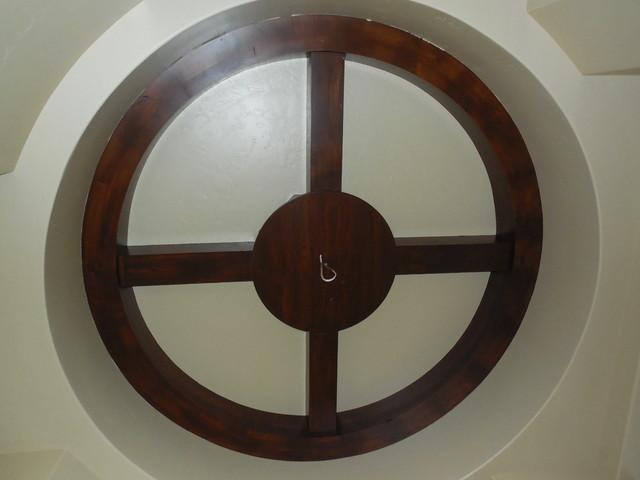 Circle Beam Built Around A Hanging Light Fixture