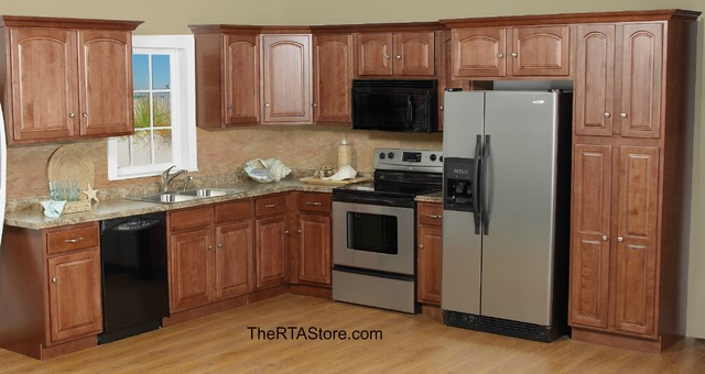 Cathedral cherry cabinets for Cathedral kitchen cabinets