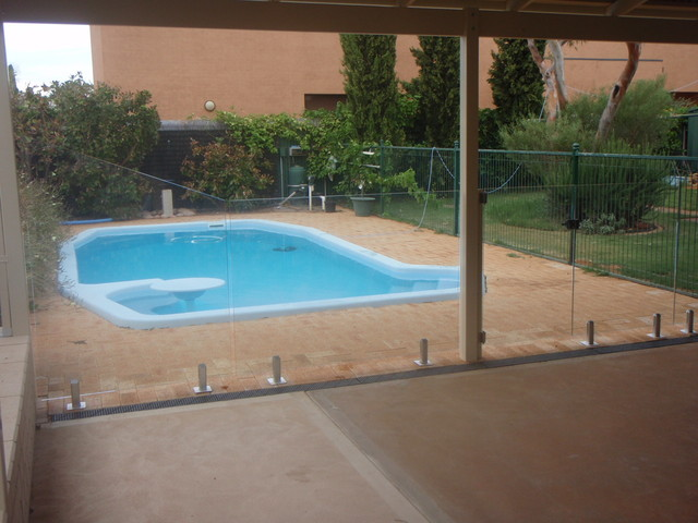 Frameless glass pool fencing home fencing gates for Glass pool gate