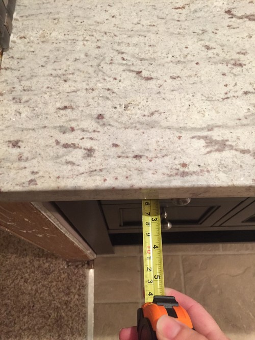 granite countertops installed with too much overhang