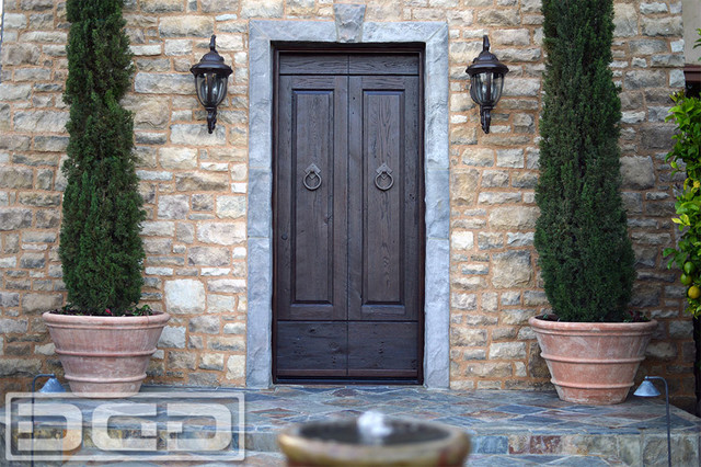 Custom made tuscan style entry door in reclaimed barn wood for Barn style exterior doors