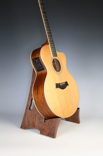 Wooden guitar stand in walnut wood artwork