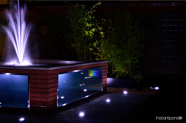 Raised bespoke koi ponds contemporary paddling pools for Koi swimming pool