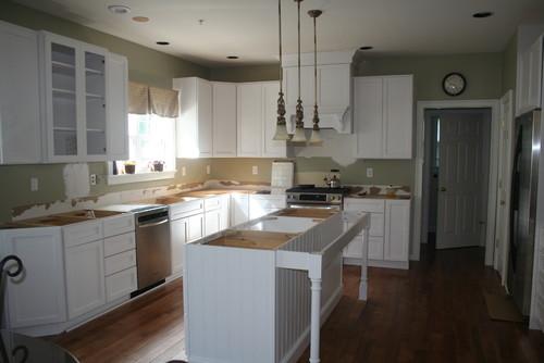Kitchen sink NOT centered w/window. Which sink will disguise it?