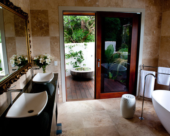 ... Decor with Dark Wood Cabinets, a Freestanding Tub and an Alcove Shower