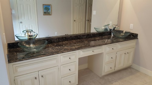 Upgraded marble vessel sinks in master bathroom for Master bathroom vessel sink