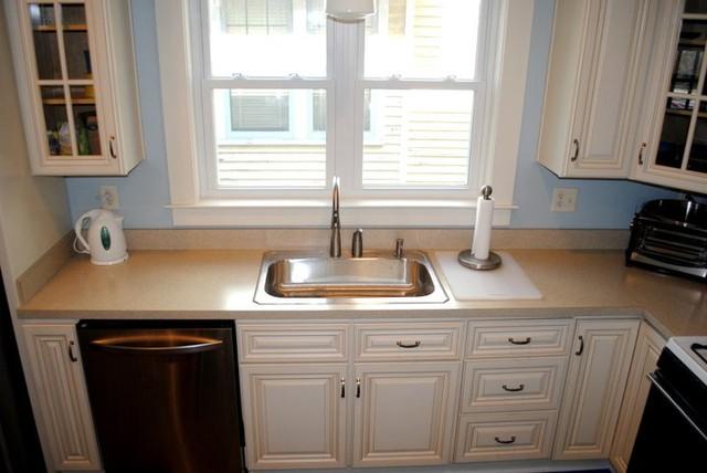cream maple cabinets in light brown glaze laminate tops and vinyl floor. Black Bedroom Furniture Sets. Home Design Ideas