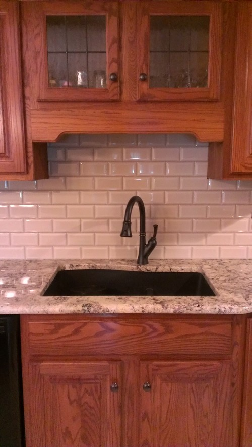 Grey Quartz Countertop And Backsplash For Oak Cabinets