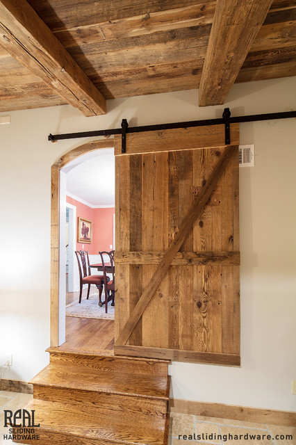Real barn doors hammered flat track sliding barn door for Real carriage hardware