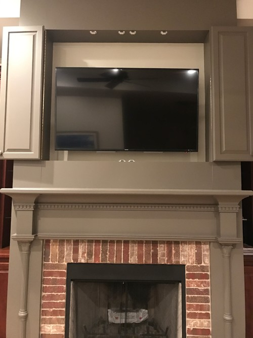 How to mount a TV above a fireplace and inside a cabinet