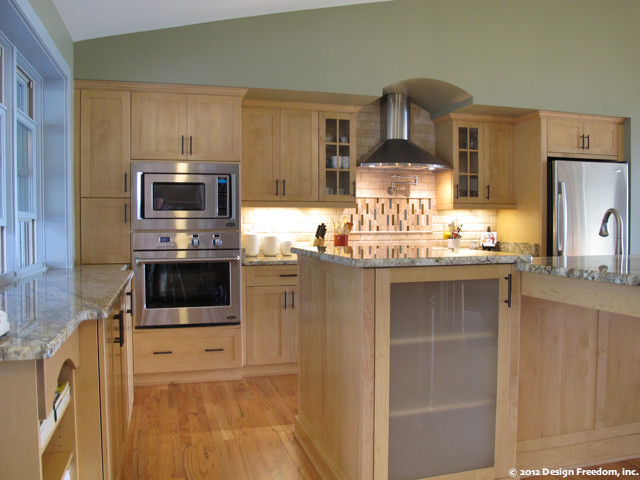 Kitchen with stainless steel appliances and light wood cabinetry - Modern - Kitchen - Tampa - by ...