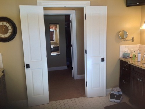 narrow french doors into master bedroom