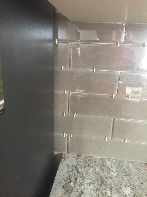 where should the glass tile backsplash end