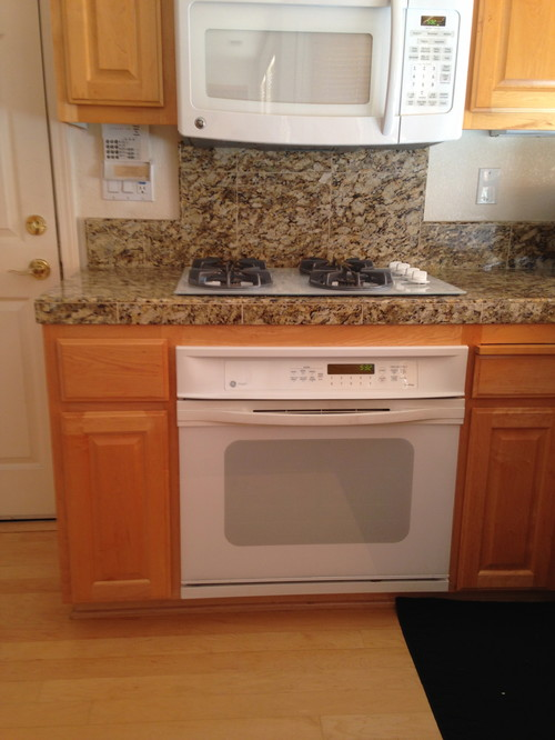 Maple cabinetry turned yellow orange what color walls for Bathroom appliances