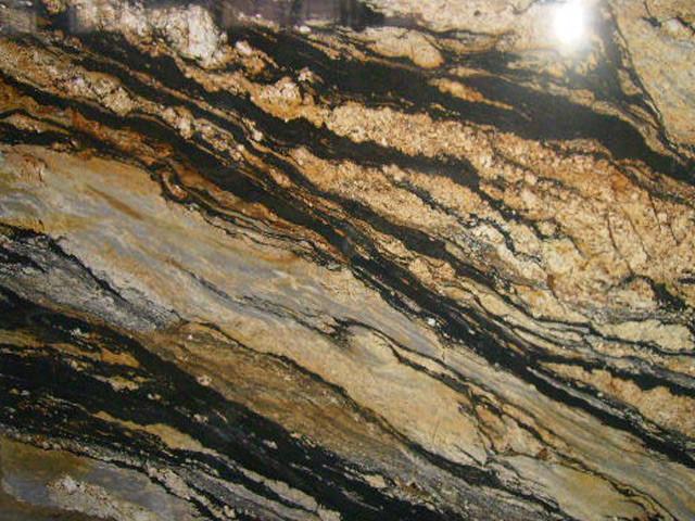 Golden Supreme Granite On Medium Colored Cabinets