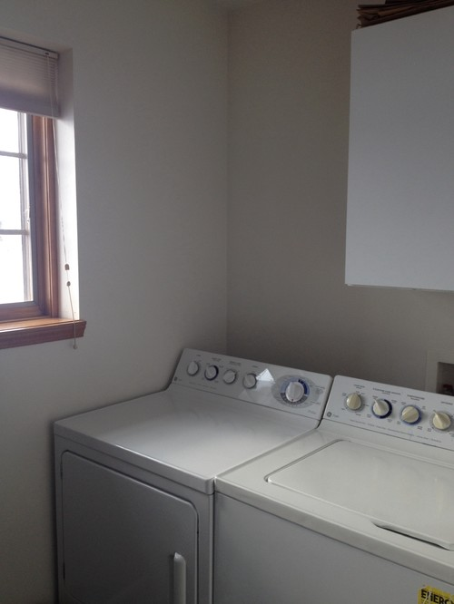 what color should i paint my small laundry room it has white cabinets