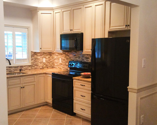 Beige Kitchen Cabinets With Black Appliances Quicuacom