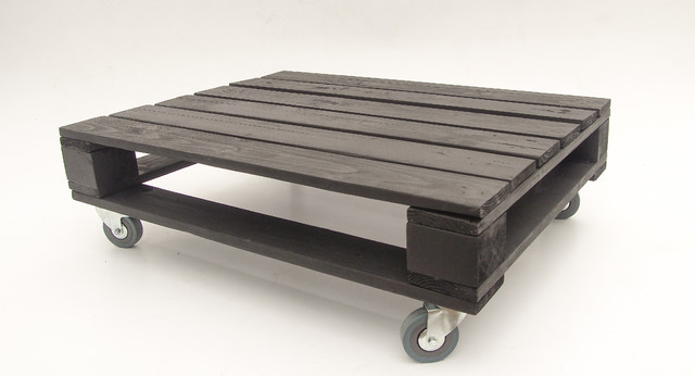 Black industrial style pallet coffee table on castor wheels for Pallet wall on wheels