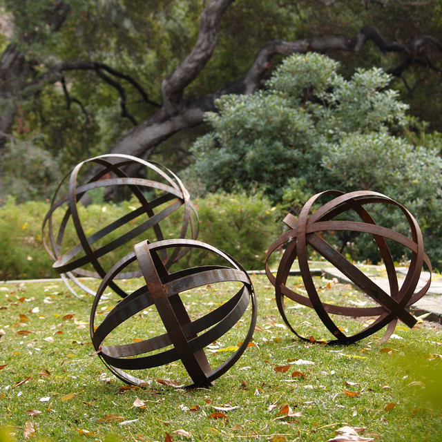 Iron sphere rusted in garden ornaments contemporary for Outdoor yard art decorations