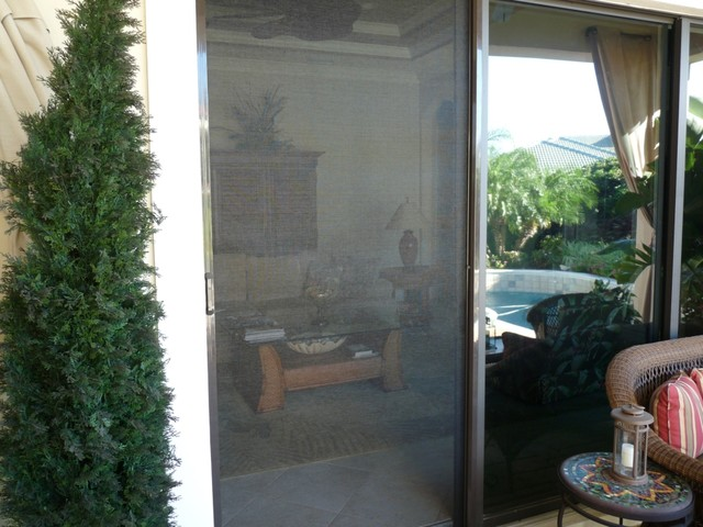 Phantom retractable screen doors traditional porch for Phantom sliding screen doors