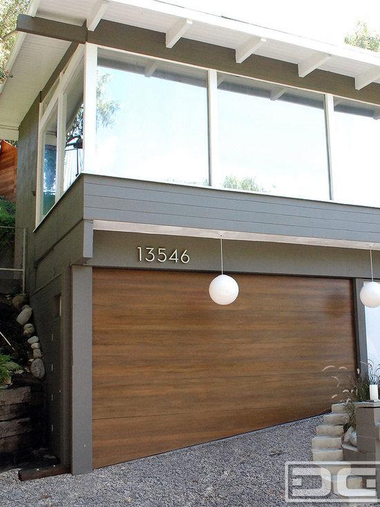 Sloped bottom garage door custom made for a carport to