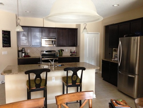 Paint color for kitchen with espresso cabinets, neutral granite, lite tile floors?