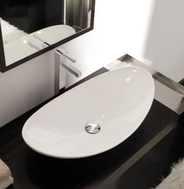 Unique oval shaped white ceramic vessel sink for Odd shaped kitchen sinks