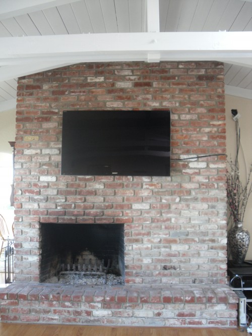 we are looking for any ideas on how to resurface the brick fireplace bring it up to date we 39 re. Black Bedroom Furniture Sets. Home Design Ideas