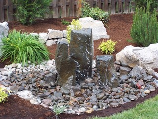 bubbler and river rock portland by valley landscape center