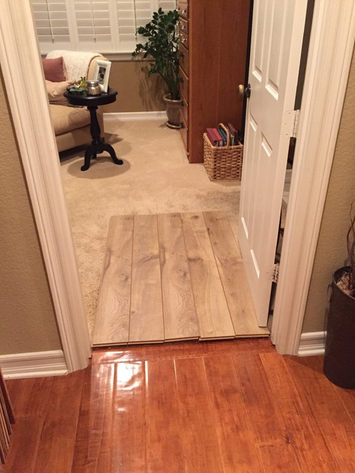 Is using 2 different wood floors ok from hallway to bedroom for Wood flooring for bedrooms