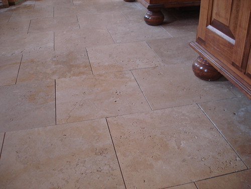 Groutless ceramic floor tile