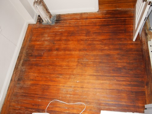 Discovering wood floors under linoleum 1920 39 s building for Hardwood flooring nearby