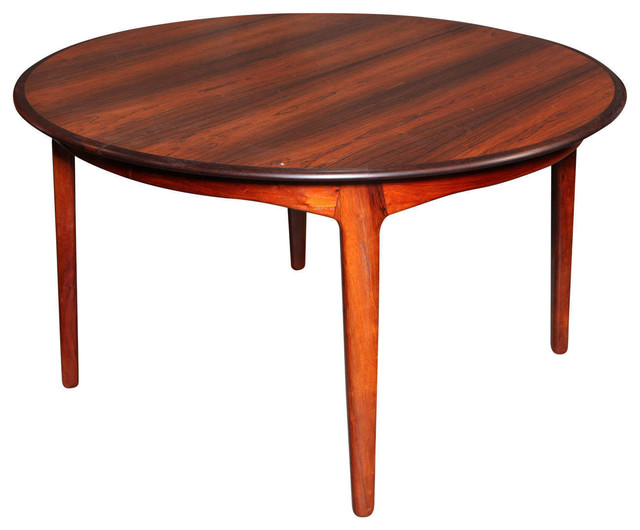 round dining table by torbjorn afdal with 4 leaves seats 12 people