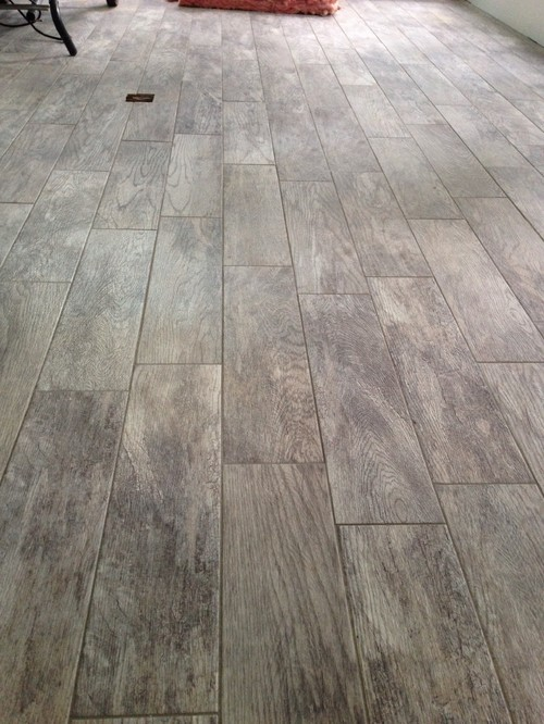 Laying wood look ceramic tile