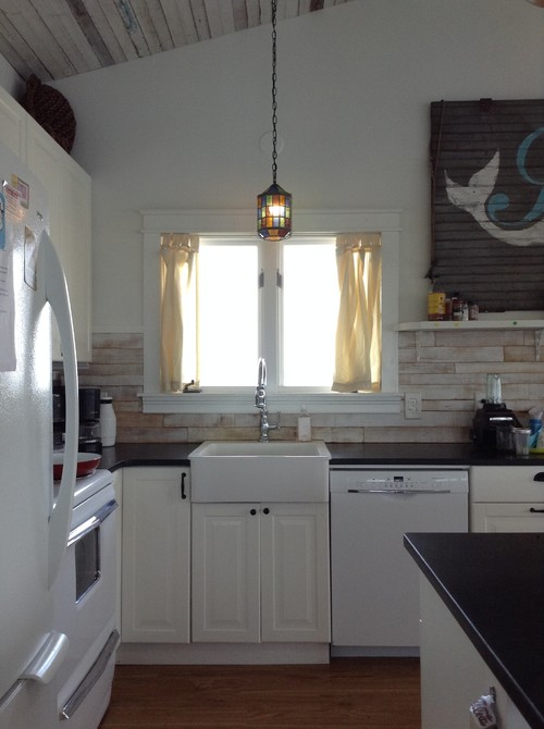 Proper curtain placement above kitchen sink for Proper kitchen layout