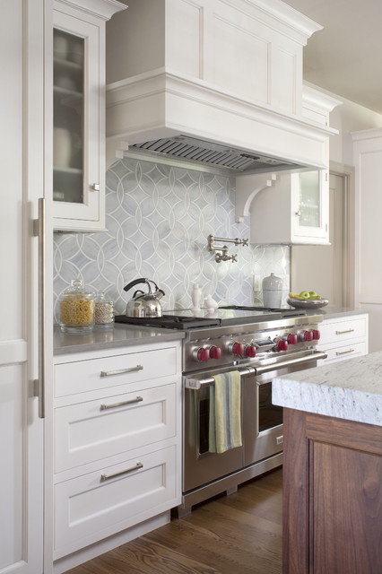 Elegant kitchen design with open cabinets below the gas stove top ...