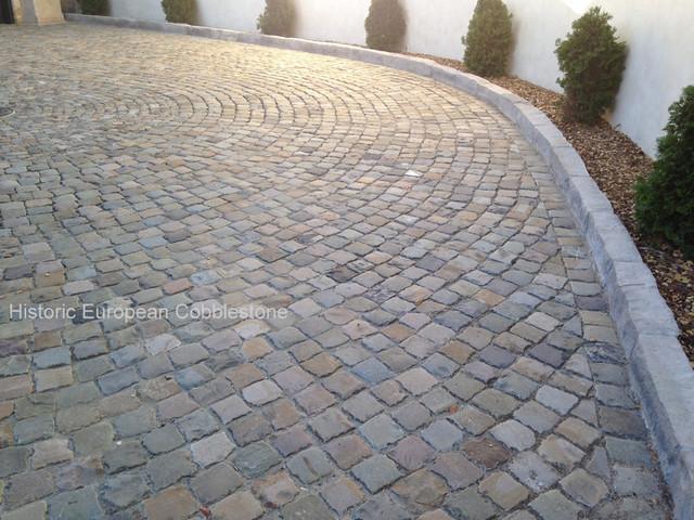 Antique sandstone cobblestone driveway pebble beach ca for Landscaping rocks orange county