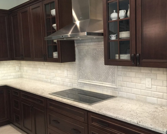 with Stainless Steel Appliances, Ceramic Floors and Dark Wood Cabinets