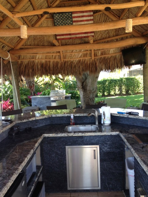 tiki hut outdoor kitchen and landscaping tropical