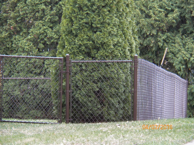 Brown vinyl coated chain link fence chesterfield michigan