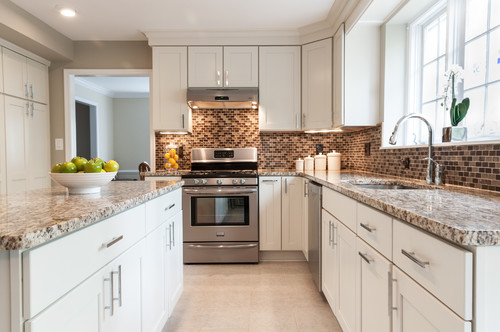 white cabinets with Santa Cecilia Granite countertop